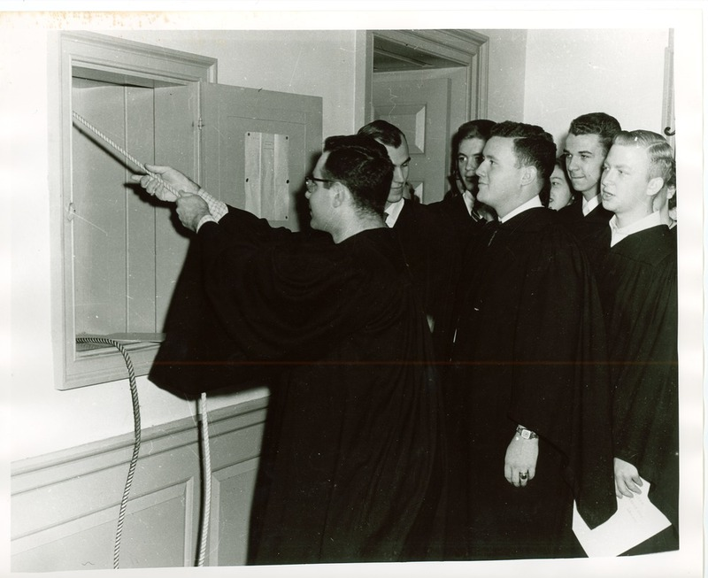 Class of 1954 seniors ringing the Wren bell, 1954
