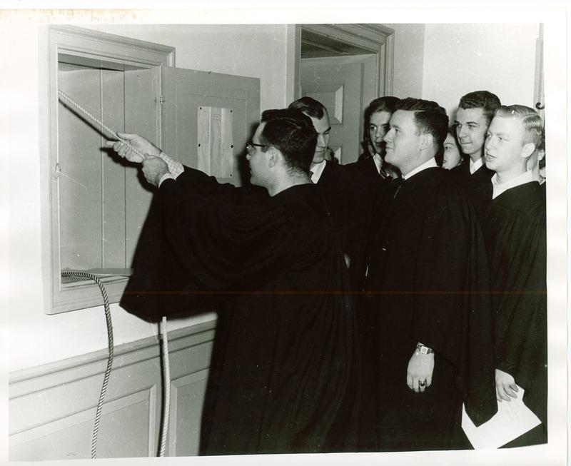 Class of 1954 seniors ringing the Wren bell, 1954